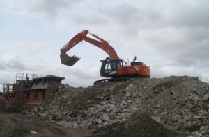 Demolition material being processed prior to re-use within the Plant construction