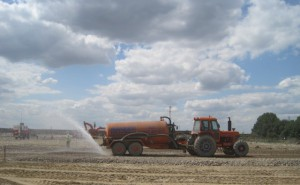 Water being sprayed on construction site to minimise dust generation